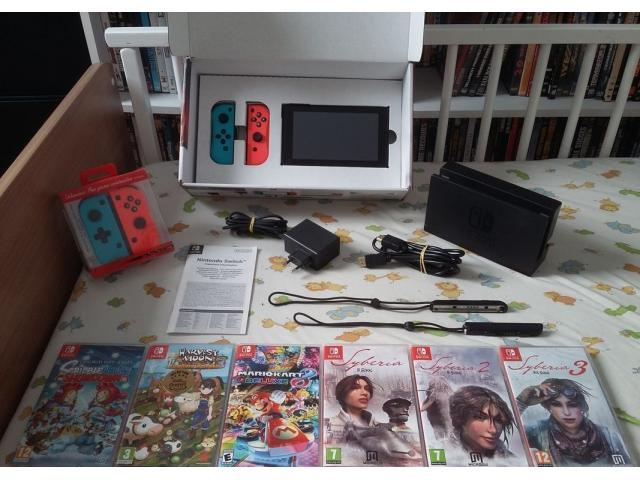 photo de Nintendo Switch + 6 jeux